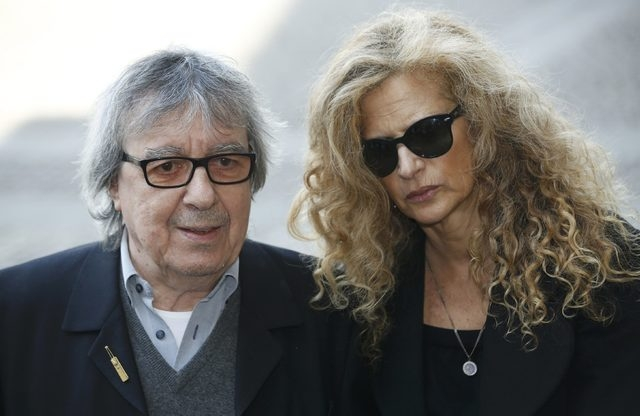 Former Rolling Stone Bill Wyman arrives with wife Suzanne Accosta for a memorial service for the broadcaster David Frost at Westminster Abbey in London, March 13, 2014. Wyman has been diagnosed wi ...