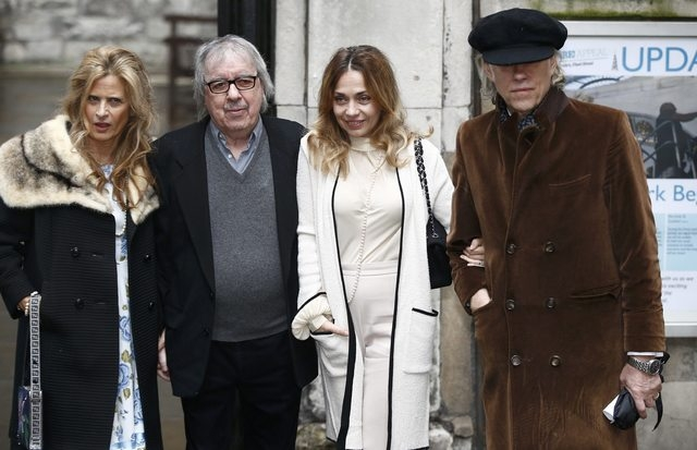 Former Rolling Stones Bill Wyman, second left, and his wife, Suzanne Accosta, left, arrive with musician Bob Geldof and his wife, Jeanne Marine, arrive at St. Bride's church for the wedding betwee ...