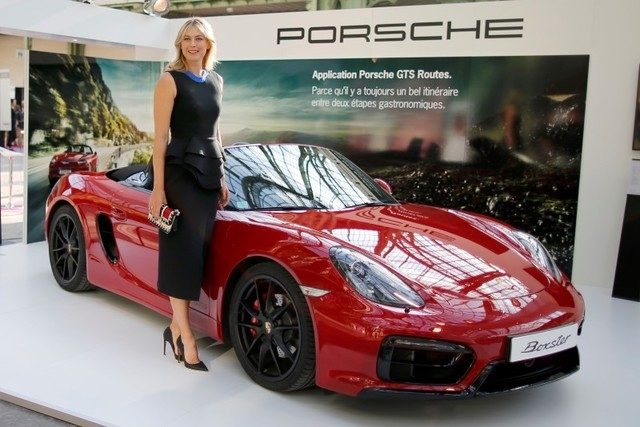 Maria Sharapova of Russia poses next to a Boxster Porsche car as she visits the Taste Festival at the Grand Palais in Paris, France, May  21, 2015. (Charles Platiau/Reuters)