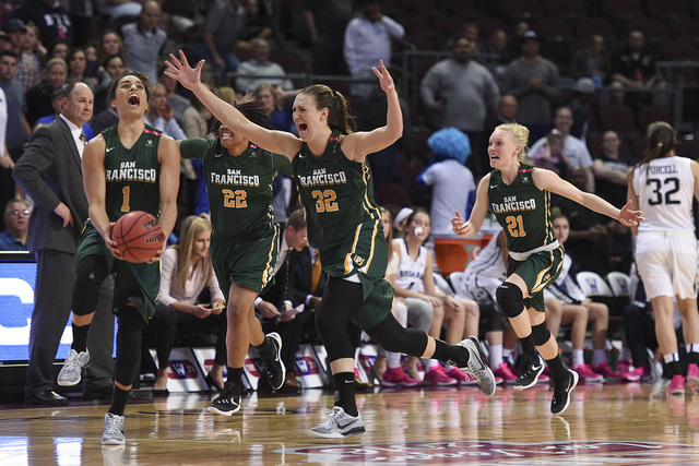 March 8, 2016; Las Vegas, NV, USA; San Francisco Dons players celebrate against the BYU Cougars after the game in the finals of the women's West Coast Conference tournament at Orleans Arena. (Kyle ...
