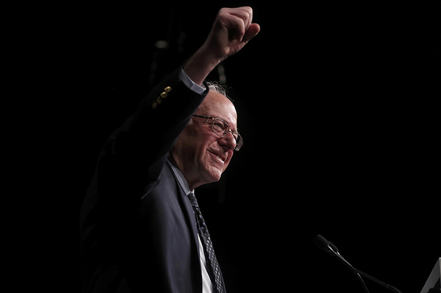 Democratic U.S. presidential candidate Senator Bernie Sanders thrusts his fist in the air as he speaks to supporters on the night of the Michigan, Mississippi and other primaries at his campaign r ...