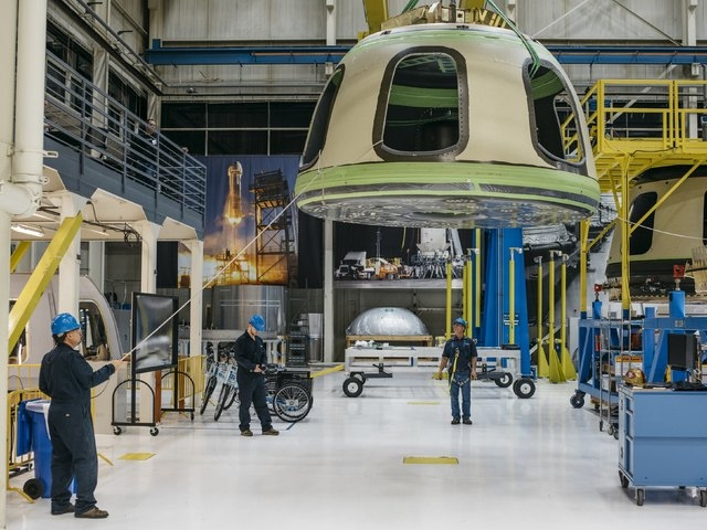Blue Origin team members ready the New Shepard Crew Capsule during assembly in Kent, Washington in this Blue Origin handout photo released March 8, 2016. REUTERS/Blue Origin/Handout via Reuters