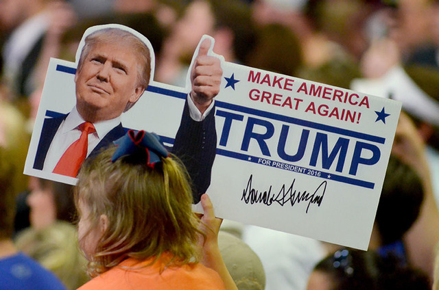 A young supporter holds up a campaign sign for U.S. Republican Presidential candidate Donald Trump at Madison Central High School during at a campaign rally in Madison, Mississippi March 7, 2016.  ...