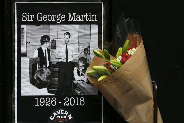A floral tribute in memory of music producer George Martin is left outside the Cavern Club in Liverpool, England, March 9, 2016. (Phil Noble/Reuters)