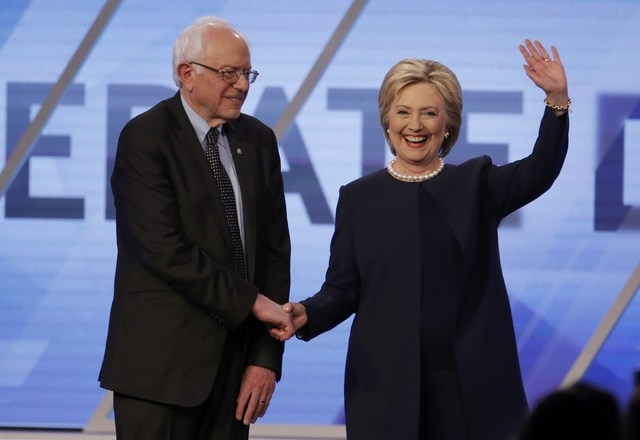 Democratic U.S. presidential candidates Senator Bernie Sanders and Hillary Clinton shake hands before the start of the Univision News and Washington Post Democratic U.S. presidential candidates de ...