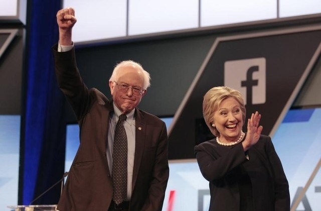 Democratic U.S. presidential candidates Senator Bernie Sanders and Hillary Clinton wave before the start of the Univision News and Washington Post Democratic U.S. presidential candidates debate in ...