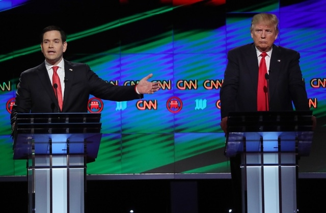 Marco Rubio speaks as rival Donald Trump listens during the Republican U.S. presidential candidates debate sponsored by CNN at the University of Miami in Florida on Thursday. (Carlo Allegri/Reuters)