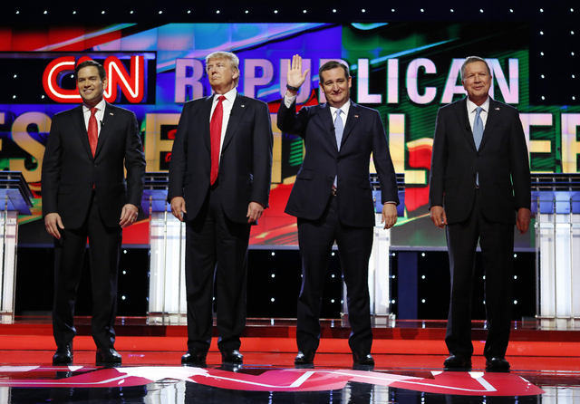 Marco Rubio, Donald Trump, Ted Cruz and John Kasich stand together onstage at the start of the Republican candidates debate sponsored by CNN at the University of Miami in Florida on Thursday.  (Jo ...