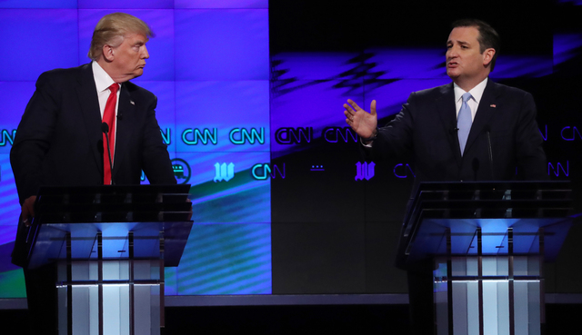 Donald Trump listens to rival Ted Cruz during the Republican candidates debate sponsored by CNN at the University of Miami in Florida on Thursday. (Carlo Allegri/Reuters)