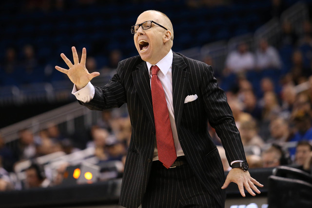 Cincinnati Bearcats head coach Mick Cronin yells from the bench in the second overtime against the Connecticut Huskies during the AAC Tournament on Friday at the Amway Center in Orlando. The Conne ...