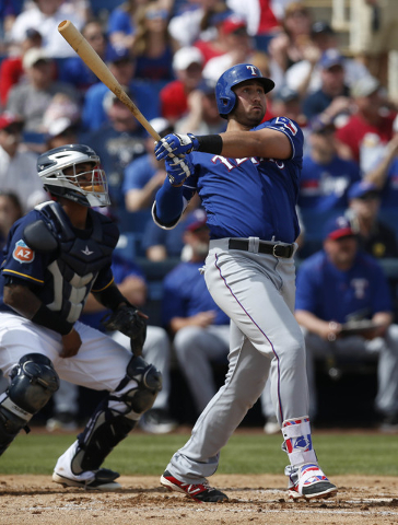 Mar 11, 2016; Phoenix, AZ, USA; Texas Rangers left fielder Joey Gallo (13) hits a three run homerun in the second inning during a spring training game against the Milwaukee Brewers at Maryvale Bas ...