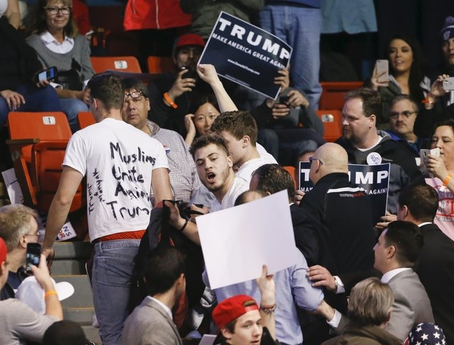 Protesters are escorted out of UIC Pavilion before Donald Trump's rally at the University of Illinois at Chicago on Friday. (Kamil Krzaczynski/Reuters)