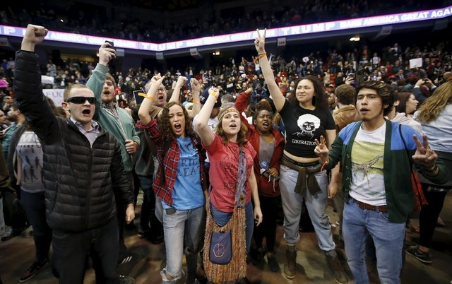 Demonstrators celebrate after Donald Trump cancelled his rally at the University of Illinois at Chicago on Friday. (Kamil Krzaczynski/Reuters)