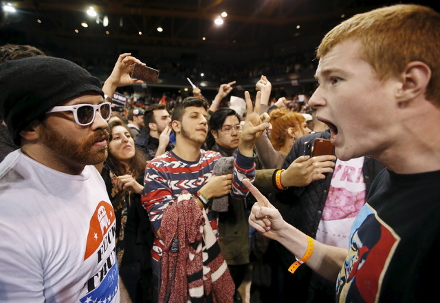 A Trump supporter, right, yells at a demonstrator after Donald Trump cancelled his rally at the University of Illinois at Chicago on Friday. (Kamil Krzaczynski/Reuters)