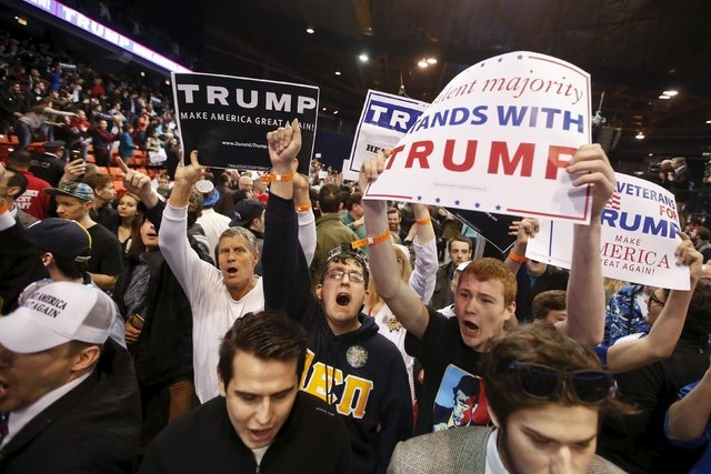 Trump supporters hold signs after Donald Trump cancelled his rally at the University of Illinois at Chicago on Friday. (Kamil Krzaczynski/Reuters)