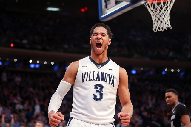Villanova Wildcats guard Josh Hart celebrates a dunk against the Providence Friars during the second half in the semifinals of the Big East conference tournament at Madison Square Garden in New Yo ...