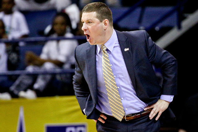 Arkansas Little Rock Trojans head coach Chris Beard yells from the sidelines against the Louisiana Monroe Warhawks during the first half of the Sun Belt Conference tournament championship game at  ...