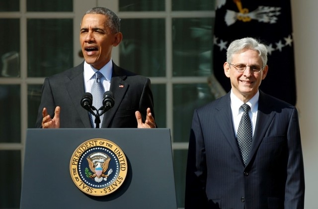 President Barack Obama, left, announces Judge Merrick Garland as his nominee to the U.S. Supreme Court, in the White House Rose Garden in Washington, March 16, 2016. (Kevin Lamarque/Reuters)