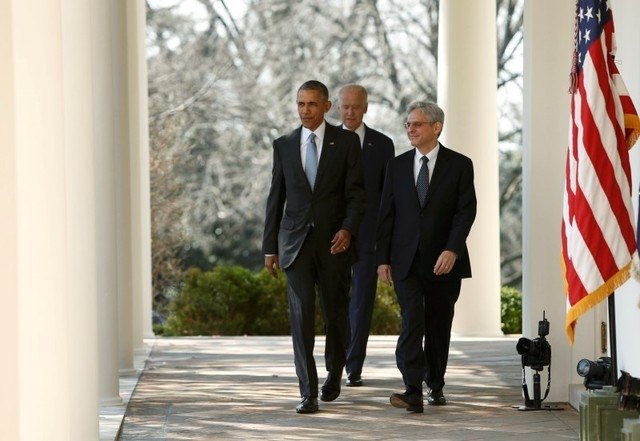 President Barack Obama, left, arrives with Judge Merrick Garland, right, and Vice President Joe Biden prior to announcing Garland as his nominee to the U.S. Supreme Court, at the White House in Wa ...