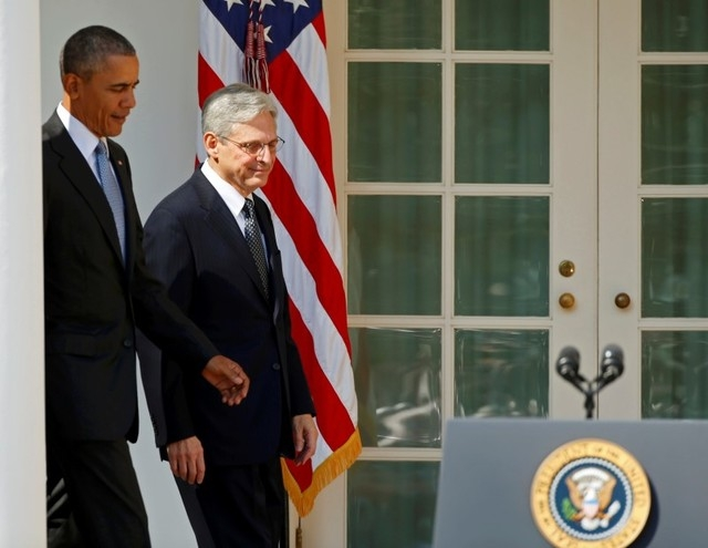 President Barack Obama, left, walks with Appeals Court Judge Merrick Garland toward a microphone to announce Garland as his nominee to the U.S. Supreme Court in the Rose Garden of the White House  ...
