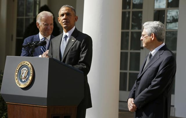President Barack Obama, left, announces Judge Merrick Garland, right, as his nominee to the U.S. Supreme Court, as Vice-President Joe Biden accompanies them in the Rose Garden of the White House i ...