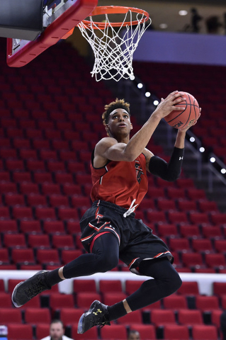 Mar 16, 2016; Raleigh, NC, USA; Texas Tech Red Raiders forward Justin Gray (5) shoots the ball during a practice day before the first round of the NCAA men's college basketball tournament at PNC A ...