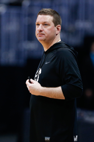 Mar 16, 2016; Denver, CO, USA; Little Rock Trojans head coach Chris Beard looks on during a practice day before the first round of the NCAA men's college basketball tournament at Pepsi Center. (Is ...