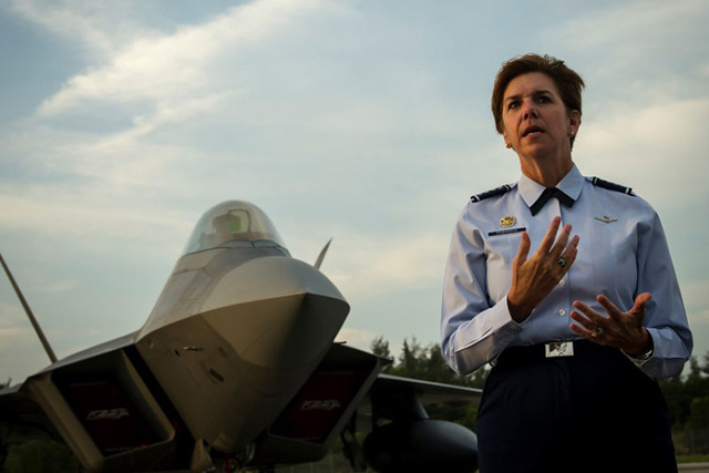 General Lori Robinson, Pacific Air Forces commander, addresses U.S. and Singapore Airmen in front of an F-22A Raptor during the Singapore International Airshow, at Changi International Airport, Si ...