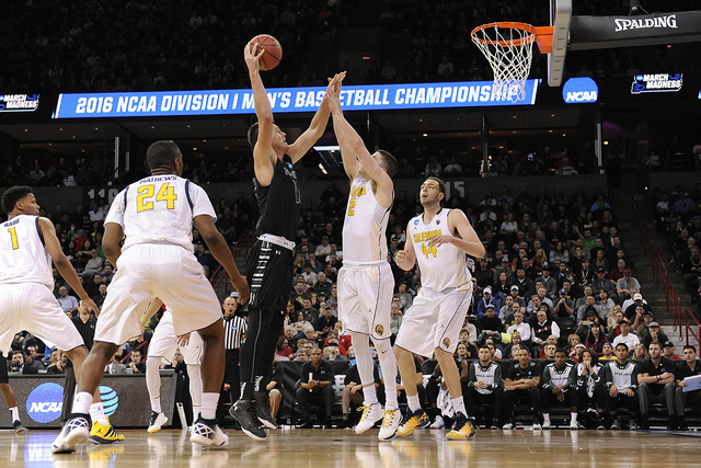 March 18, 2016; Spokane , WA, USA; Hawaii Rainbow Warriors center Stefan Jovanovic (15) moves in to score a basket against California Golden Bears guard Sam Singer (2) during the second half of th ...