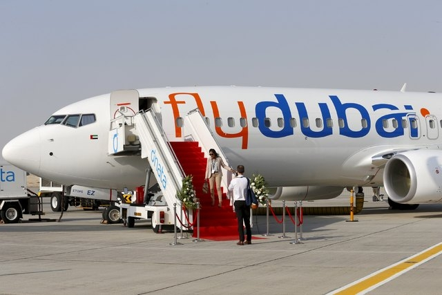 """A Flydubai plane is pictured at the Dubai Airshow in this November 8, 2015 file photo. Dubai-based airline Flydubai said on March 19, 2016 that it was investigating an """"incident"""" regarding one of  ..."""