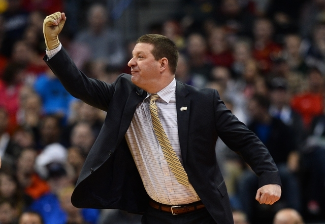 Mar 19, 2016; Denver , CO, USA; Arkansas Little Rock Trojans head coach Chris Beard gestures from court side in first half action of Iowa State vs Arkansas Little Rock during the second round of t ...