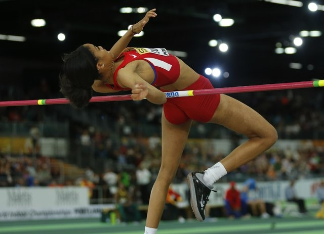 Vashti Cunningham of the U.S. jumps on her way to the gold medal in the women's high jump during the IAAF World Indoor Athletics Championships in Portland, Oregon March 20, 2016. REUTERS/Mike Blake