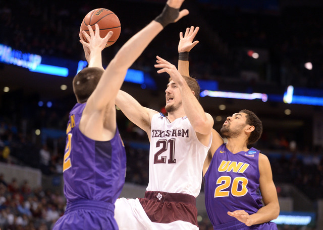 Texas A&M Aggies guard Alex Caruso (21) shoots against Northern Iowa Panthers guard Jeremy Morgan (20) and forward Klint Carlson (2) in the second half during the second round of the 2016 NCAA ...