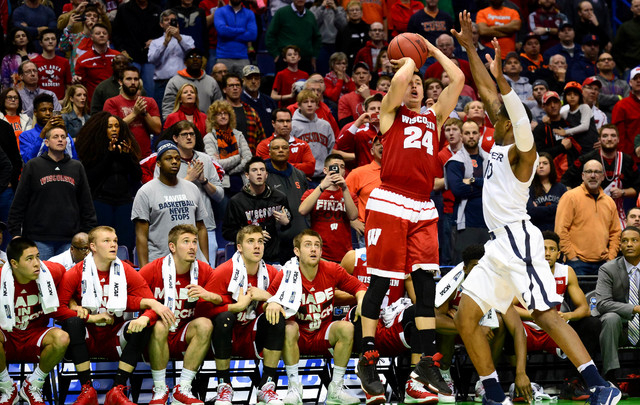 Wisconsin Badgers guard Bronson Koenig (24) shoots the game-winning shot over Xavier Musketeers guard Remy Abell (10) during the second half of the second round in the 2016 NCAA Tournament at Scot ...