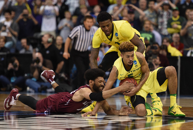 Oregon Ducks guard Tyler Dorsey (5) and forward Jordan Bell (1) play for the ball against St. Joseph's Hawks forward DeAndre Bembry (43) during the second half in the second round of the 2016 NCAA ...