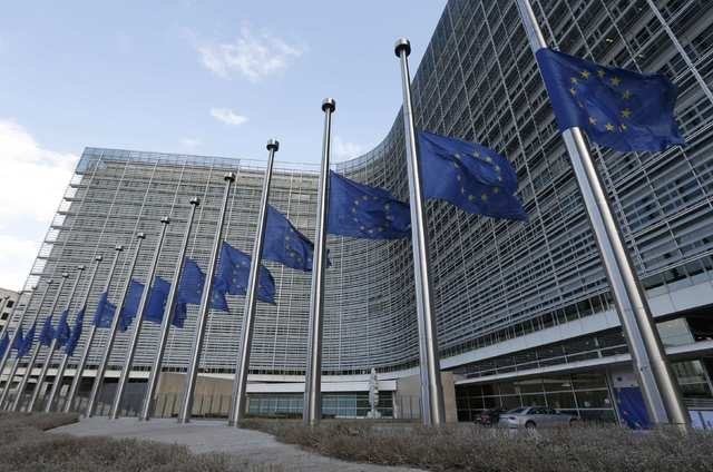 European flags fly at half-mast in front of the European Commission headquarters in tribute to victims from the morning explosions in Brussels, Belgium, March 22, 2016.   REUTERS/Vincent Kessler