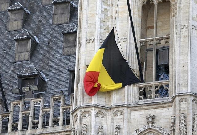 A Belgian flag flies at half-mast following bomb attacks s in Brussels, Belgium, March 22, 2016.    REUTERS/Charles Platiau