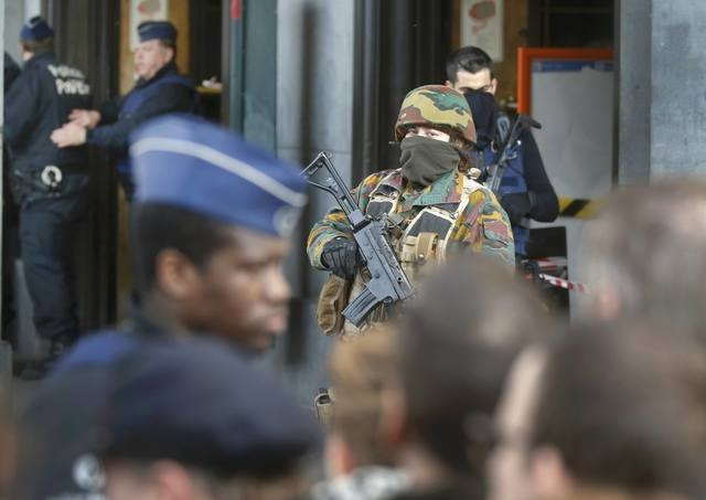Police control the access to the central train station following bomb attacks in Brussels, Belgium, March 22, 2016.    (Christian Hartmann/Reuters)