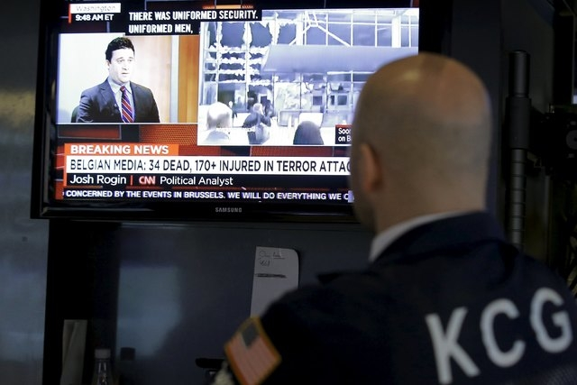 A specialist trader watches developments following the explosions in Brussels, on the floor of the New York Stock Exchange (NYSE) March 22, 2016. REUTERS/Brendan McDermid
