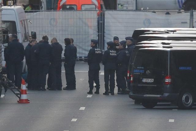 Belgian police work near the Maalbeek metro station following bomb attacks in Brussels, Belgium, March 22, 2016.   (Vincent Kessler/Reuters)