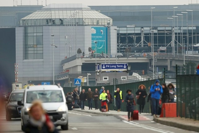 People leave the scene of explosions at Zaventem airport near Brussels, Belgium, March 22, 2016.  (Francois Lenoir/Reuters)
