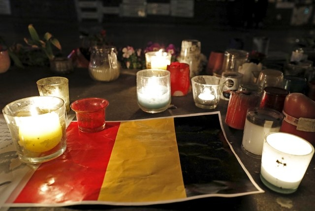 Candles are pictured around a Belgian flag on the Place de la Republique in Paris, France following bomb attacks in Brussels, Belgium, March 22, 2016. (Philippe Wojazer/Reuters)