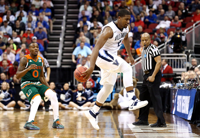 Mar 24, 2016; Louisville, KY, USA; Villanova Wildcats forward Kris Jenkins (2) saves a ball from going out of bounds against Miami Hurricanes guard Ja'Quan Newton (0) during the second half in a s ...