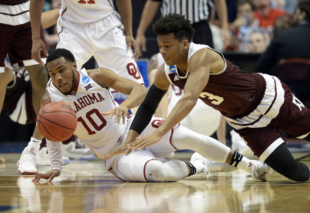 March 24, 2016; Anaheim, CA, USA; Oklahoma Sooners guard Jordan Woodard (10) plays for the ball against Texas A&M Aggies guard Admon Gilder (3) during the second half  of the semifinal game in ...