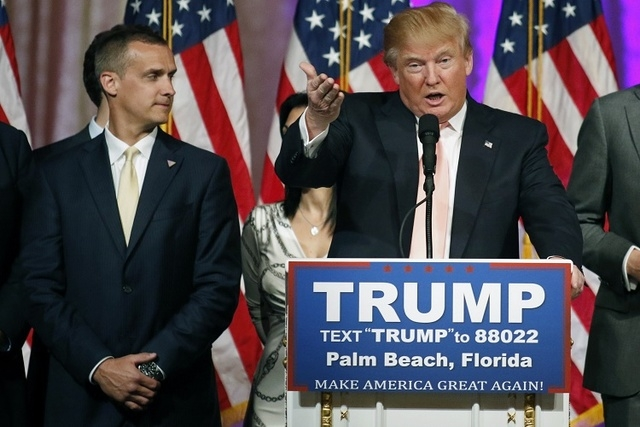 Campaign manager Corey Lewandowski, left, stands next to Republican presidential candidate Donald Trump during a news conference in Palm Beach, Florida, March 15, 2016. (Joe Skipper/Reuters/Files)