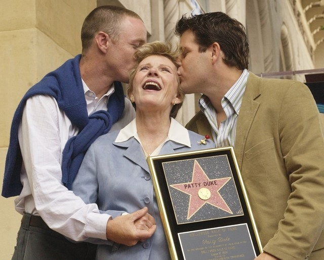 Award-winning actress Patty Duke receives a kiss from sons, MacKenzie, left, and Sean Astin following an unveiling ceremony honoring Duke with the 2,260th star on the Hollywood Walk of Fame in Los ...