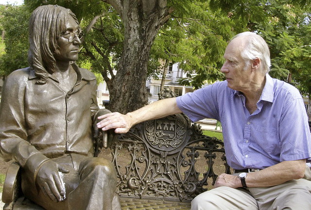 Beatles producer George Martin touches a statue of John Lennon in a park in the Vedado neighborhood of Havana, during his visit to Cuba, Oct. 30, 2002. (AP Photo/Cristobal Herrera, File)