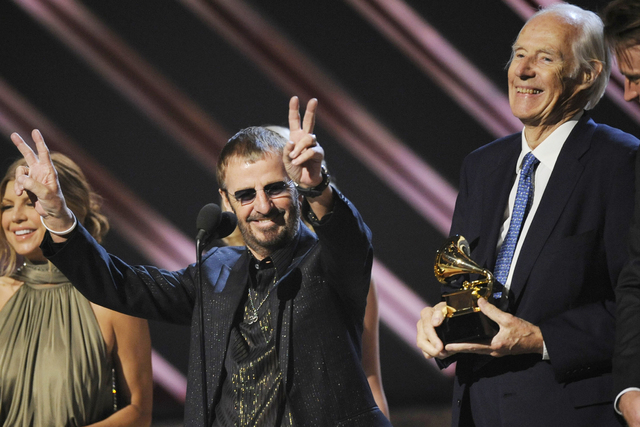 "Musician Ringo Starr, center, and Beatles producer Sir George Martin accept the best compilation soundtrack album award for ""Love"" during the 50th annual Grammy awards held at the Staples Center i ..."