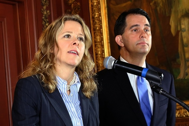 In this Oct. 9, 2015, file photo, Judge Rebecca Bradley speaks at the State Capitol in Madison, Wis., after being appointed to the Wisconsin Supreme Court by Governor Scott Walker, right. (John Ha ...