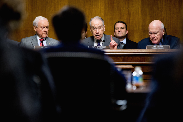 Senate Judiciary Committee Chairman Sen. Charles Grassley, R-Iowa, center, flanked by the committee's ranking member Sen. Patrick Leahy, D-Vt., right, and Sen. Orrin Hatch, R-Utah, questions Attor ...
